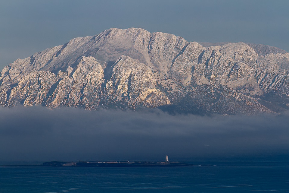 THE DJEBEL MUSA, ON THE MOROCCAN COAST, LOOKS SPECTACULAR FROM TARIFA. WE WILL CARRY OUT THE SEAWATCHING FROM THE LIGHTHOUSE OF TARIFA. PHOTOGRAPH BY JAVI ELORRIAGA, BIRDING THE STRAIT.